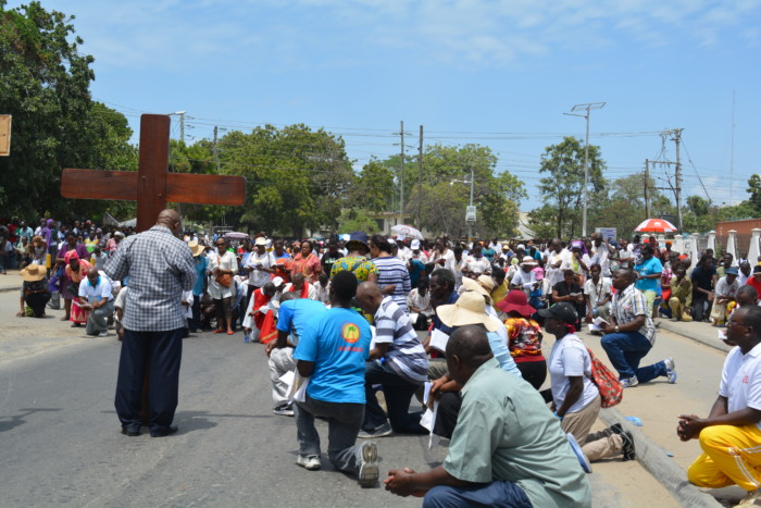 Catholic faithfuls kneeling down during the procession PHOTO Paul Nzioka