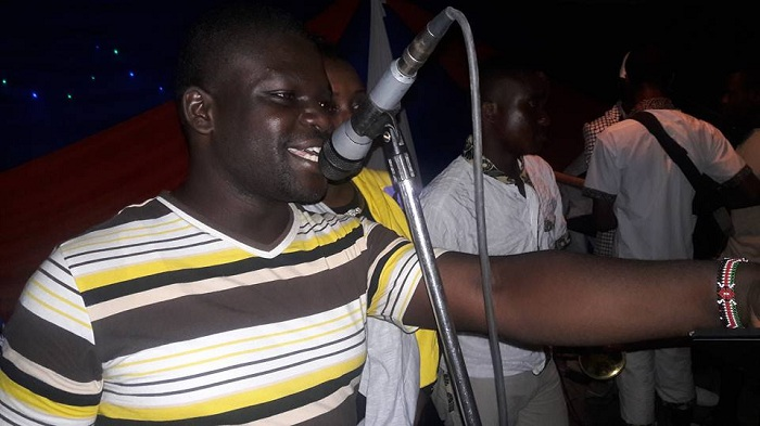 Billy Miya trying his music skills in Bango PHOTO:PAUL NZIOKA