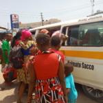 Passenger boarding a matatu
